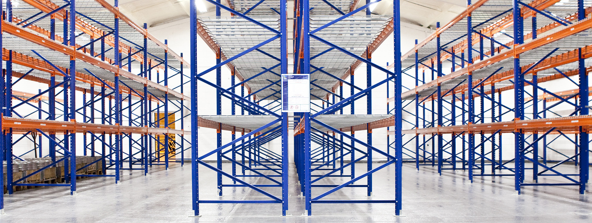 services-warehouse-label-install-racks-orange-warehouse-brand-new-dls